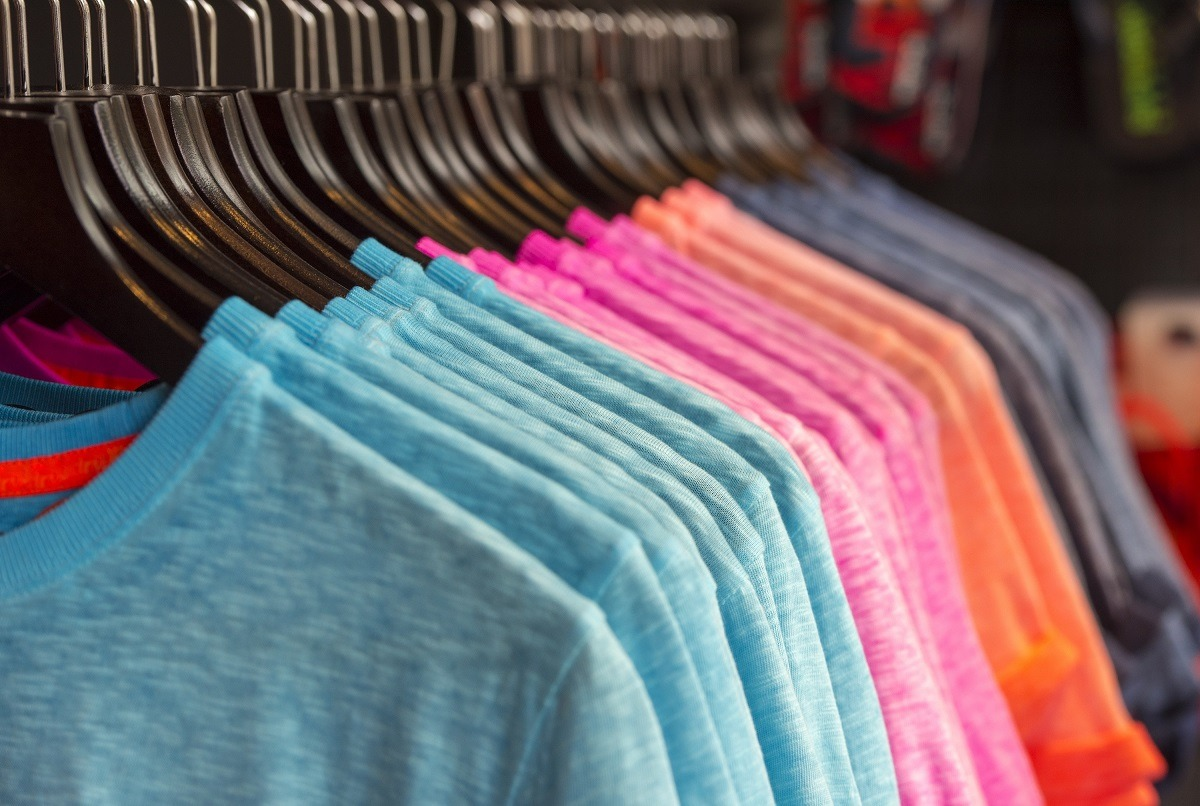 Colorful shirts on hangers